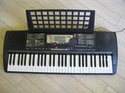 синтезатор  YAMAHA PSR 225 ( 61 активная  клавиша )